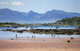 Beach At Millport With The Arran Hills In View, Isle Of Cumbrae. (Photo by: Education Images/UIG via Getty Images)